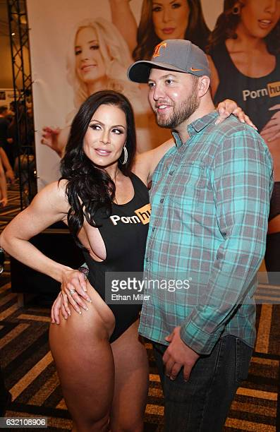Adult film actress Kendra Lust poses for a photo with Daniel Thurman of Tennessee at the Pornhub booth at the 2017 AVN Adult Entertainment Expo at...