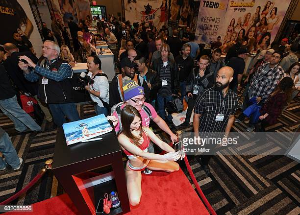 Adult film actress Riley Reid takes photos with fans at Greg Lansky's Blacked Tushy and Vixen adult studios booth at the 2017 AVN Adult Entertainment...