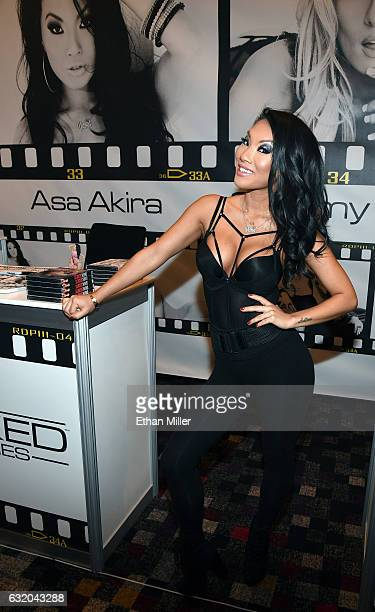 Adult film actress/director Asa Akira appears at the Wicked Pictures booth at the 2017 AVN Adult Entertainment Expo at the Hard Rock Hotel Casino on...