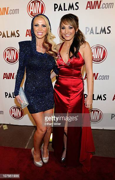 Adult film actresses Nikki Benz and Charlie Laine arrive at the 28th annual Adult Video News Awards Show at the Palms Casino Resort January 8 2011 in...