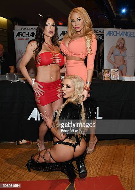 Adult film actresses Nina Elle Kendra Lust and Summer Brielle pose at the ArchAngel booth at the 2016 AVN Adult Entertainment Expo at The Joint...