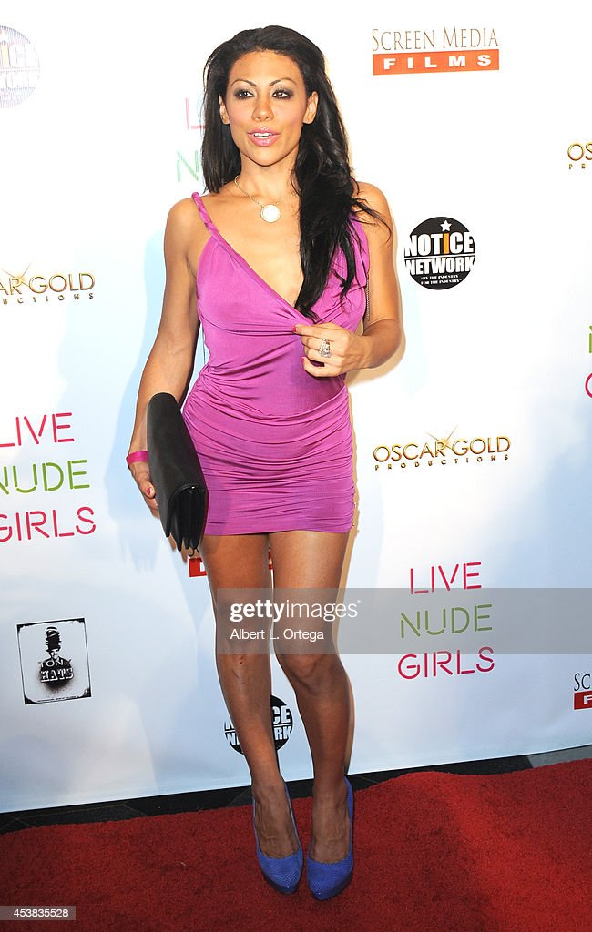 Adult film star Cassandra Cruz arrives at the premiere of 'Live Nude Girls' held at Avalon on August 12, 2014 in Hollywood, California.