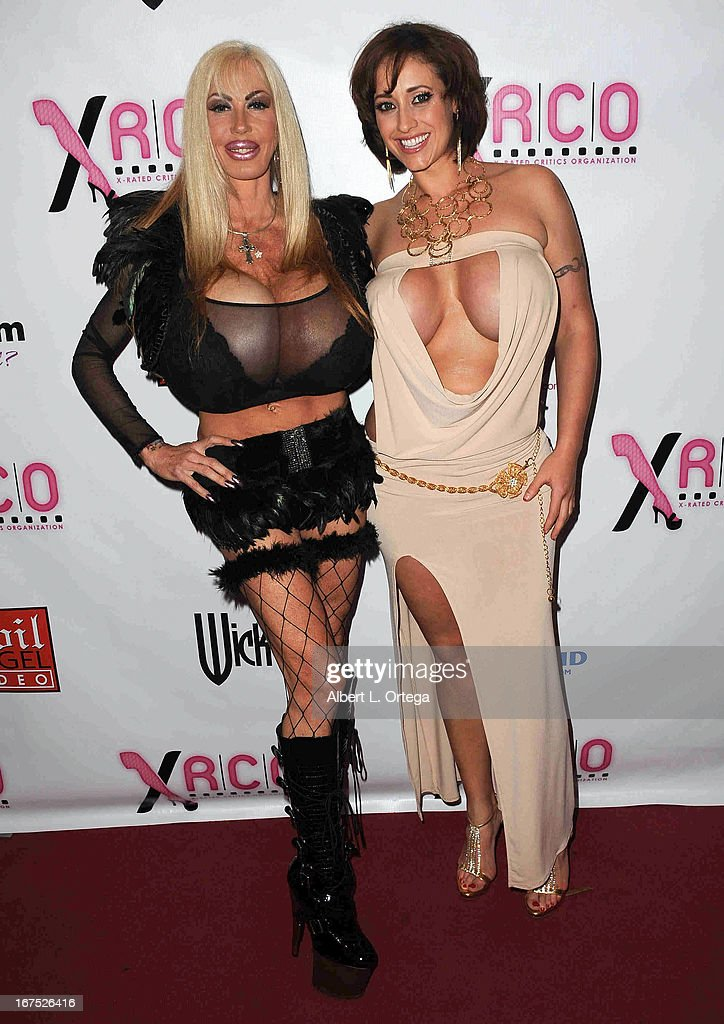 Adult film stars Elizabeth Satrr and Eva Naughty arrive for the 29th Annual XRCO Awards held at SupperClub Los Angeles on April 25, 2013 in Hollywood, California.