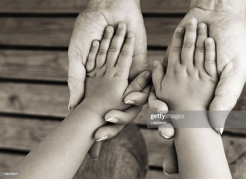 Adult Holding Child's Hands : Stock Photo