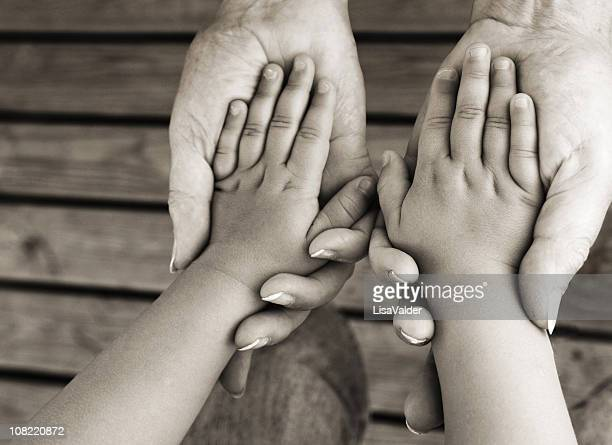 Adult Holding Child's Hands