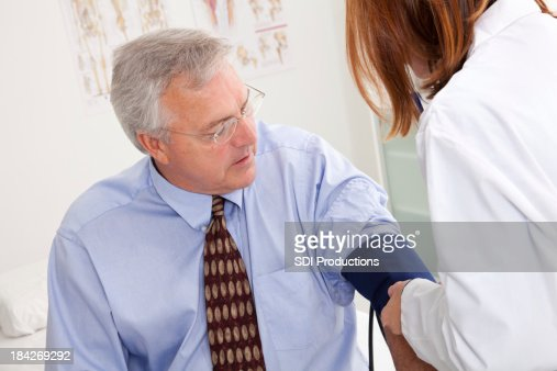 Adult Male Patient Having Blood Pressure Taken at Doctor's Office