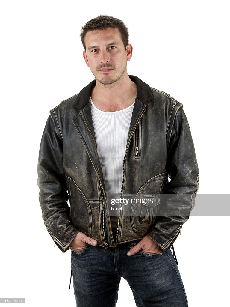 Adult male with serious expression wearing leather