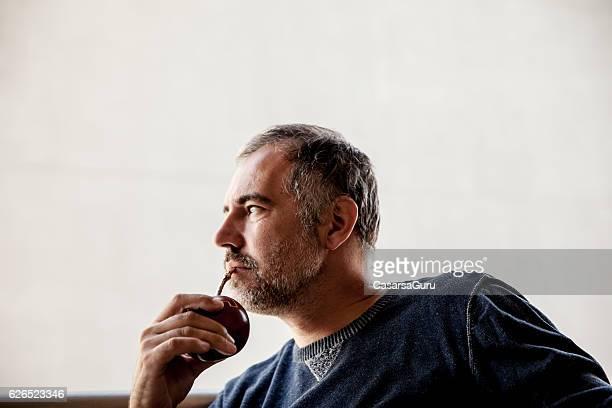 Adult man Drinking Yerba Mate