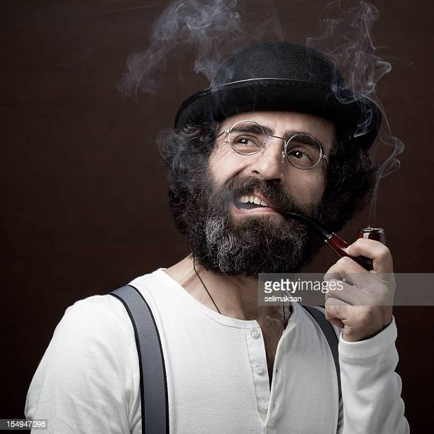 Adult man in 1800s style costume smoking pipe