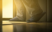 Adult man in pijamas walks to a bathroom at the night. Men's healths concept