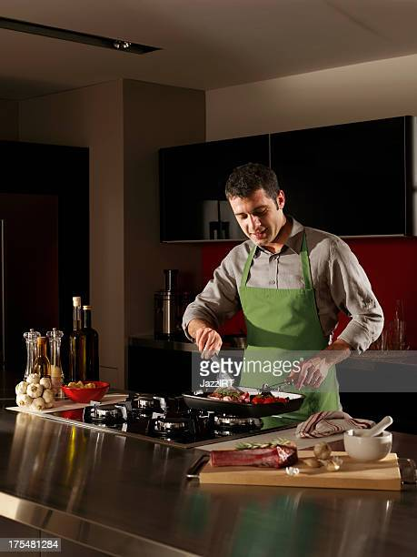 Adult man in the kitchen cooking