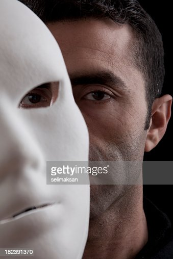 Adult Man Peeking Behind Mask In Vertical Composition