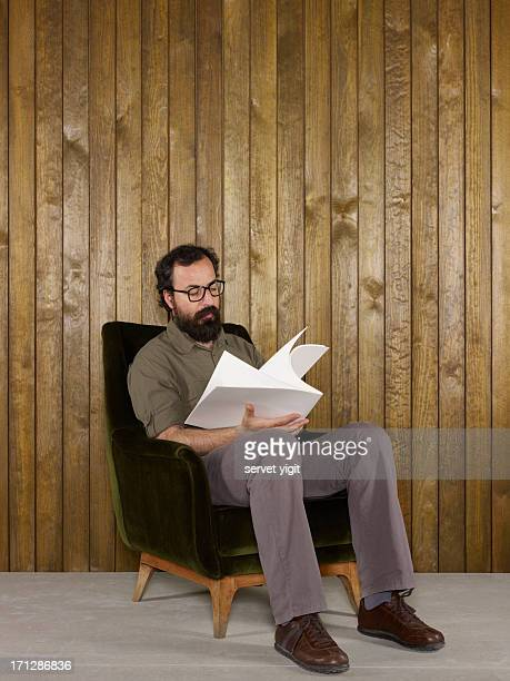 Adult Man Reading A White Covered Book