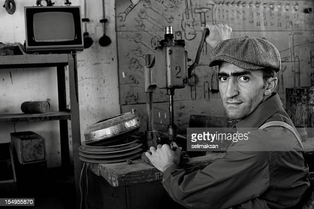 Adult man working in old fashined garage