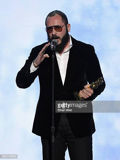 Adult producer/director Greg Lansky accepts the award for Best Director during the 2017 Adult Video News Awards at The Joint inside the Hard Rock...