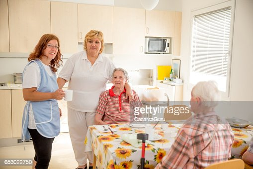 Adult Senior Socializing In The Dining Room Of The Care Center : Photo