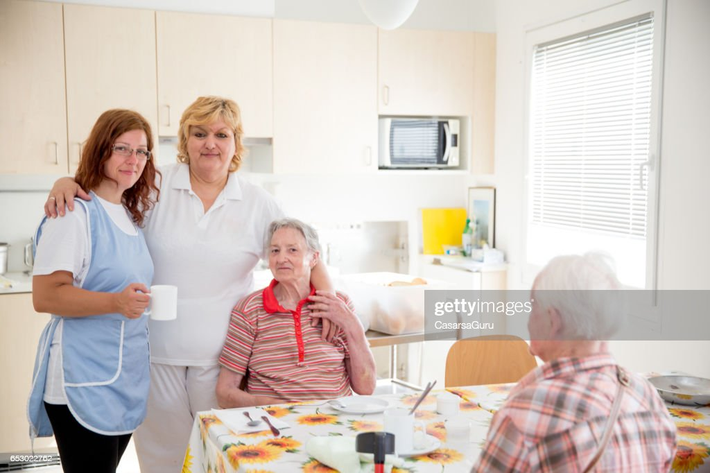 Adult Senior Socializing In The Dining Room Of The Care Center : Stock Photo