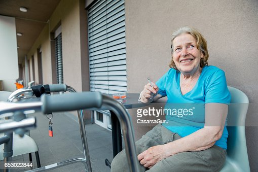 Adult Senior Woman In The Care Center Taking Break : Stock Photo