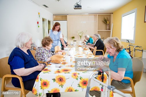 Adult Seniors Having Breakfast At The Care Center : Bildbanksbilder
