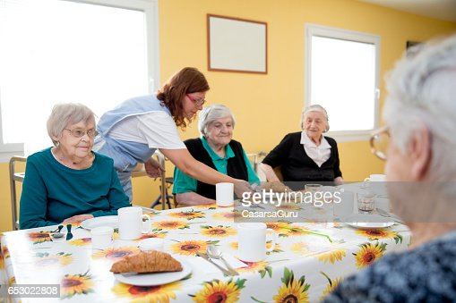 Adult Seniors Having Breakfast At The Care Center : Stock-Foto
