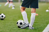 Adult Soccer Training Session. Football Player with Ball on the Field