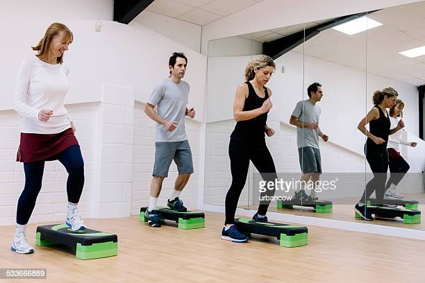 Adult step aerobics class in an exercise studio
