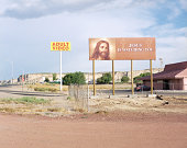 Adult video sign next to Jesus sign