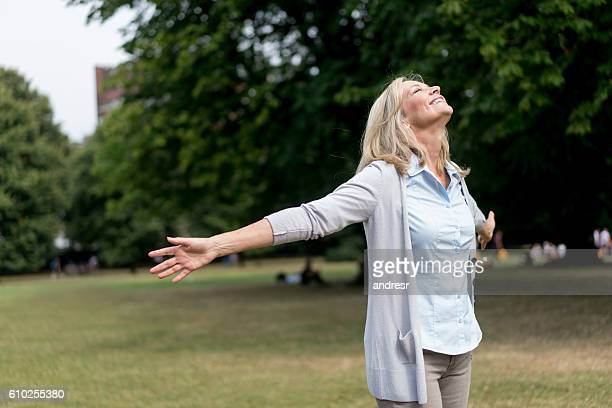 Adult woman enjoying her time at the park