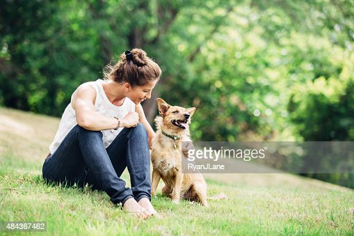 Adult Woman Enjoying Time with Pet Dog