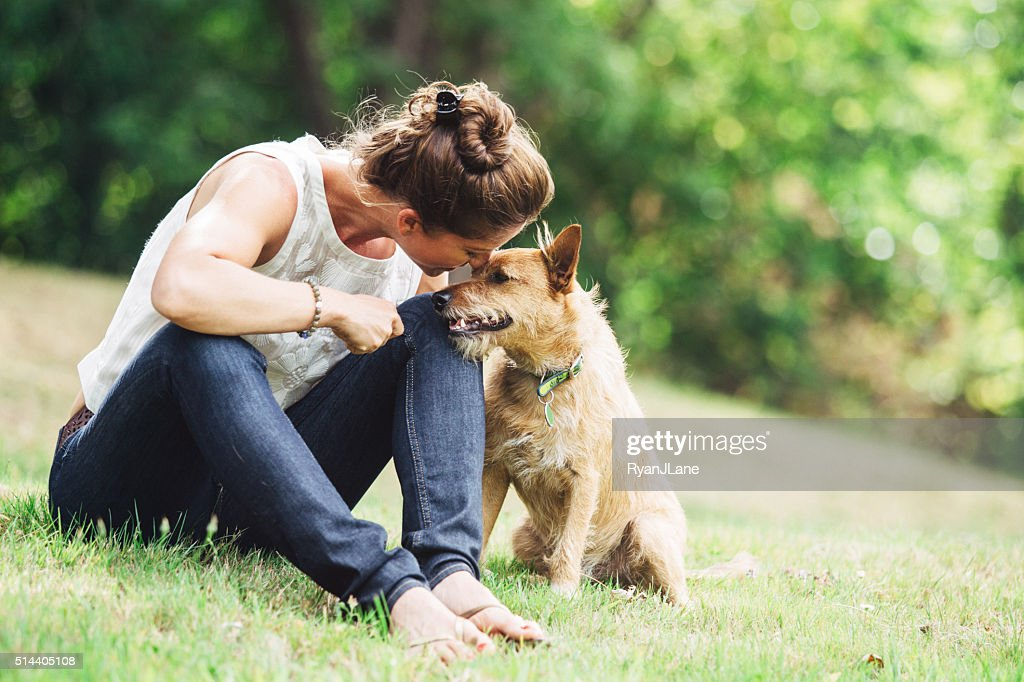 Adult Woman Enjoying Time with Pet Dog : Stock Photo