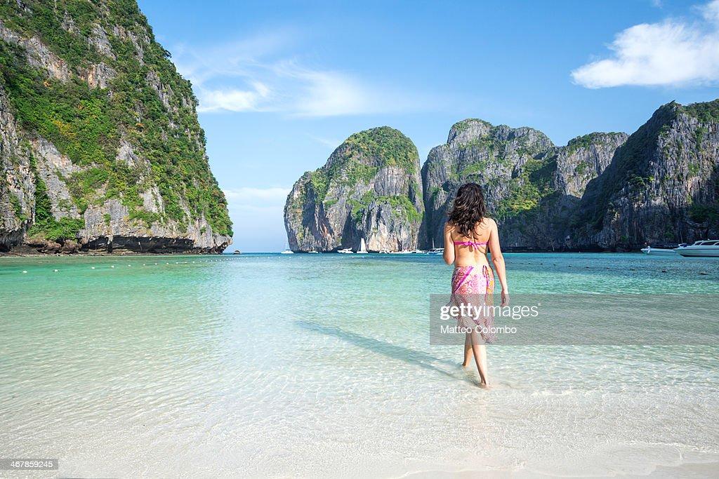 Adult woman in bikini on tropical beach, Thailand