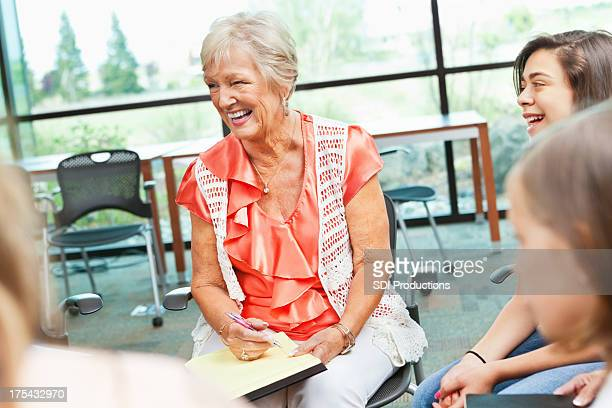 Adult woman laughing in a meeting