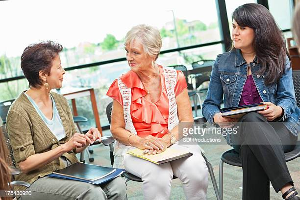 Adult woman talking together in a meeting