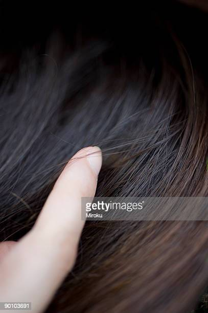 Adult woman touching her hair, Close Up