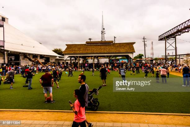 WACO, TX, USA  MARCH 18, 2017:  Adults and children playing football and frisbee while waiting in the relaxation area behind Magnolia Market at the Silos.