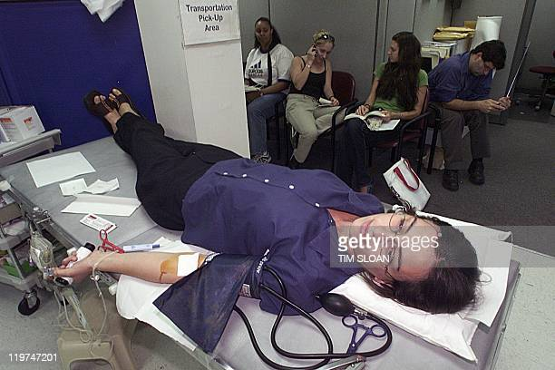 Adults and college students donate blood at a Red Cross blood bank just blocks from the White House on a day where a State of Emergency has been...