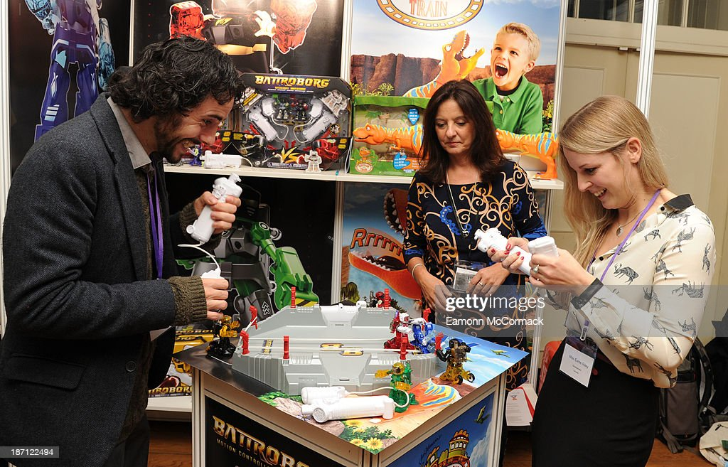 Adults play with the Battrobors toy at the Dream Toys 2013 press day at St Mary's on November 6, 2013 in London, England.