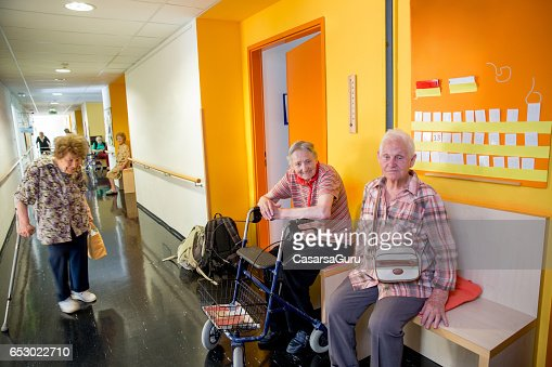 Adults Senior Socialize In The Hall Of Care Center : Stock-Foto