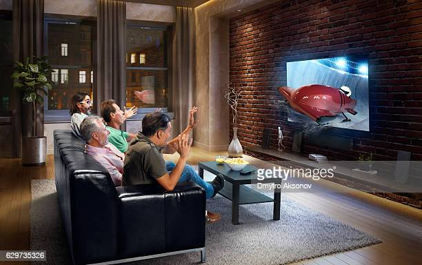 Adults watching Bobsleigh race at home