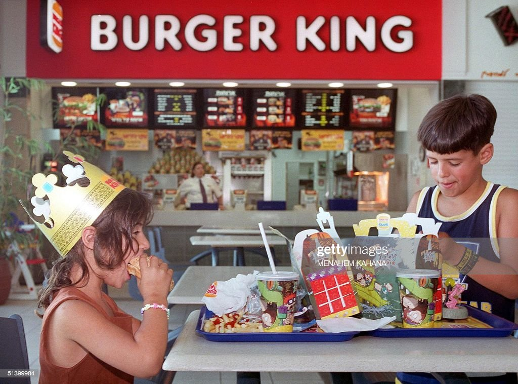 Jewish settler children enjoy a Burger King meal in the West Bank settlement of Ma'ale Adumim 09 August 1999. The Arab League has threatened to stage a boycott of the US fast-food chain after it opened a new restaurant in the Jewish settlement, which is located on land seized by Israel in the 1967 Six-Day war.