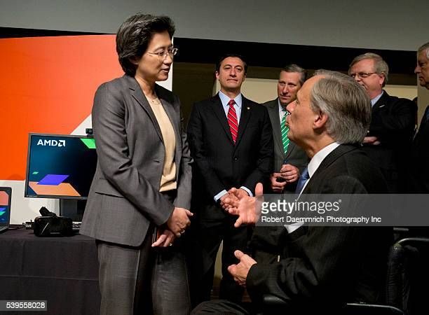 Advanced Micro Devices President and CEO Lisa T Su greets Texas Governor Greg Abbott following Abbott's bill signing that will cut Texas' franchise...