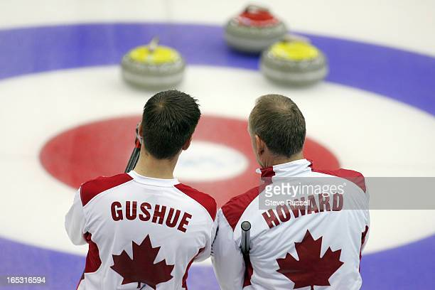 ADVANCES02/22/06Brad Gushue and Russ Howard discuss a shot as their rink advances to the Gold Medal game after beating USA 115 at the Pinerolo...