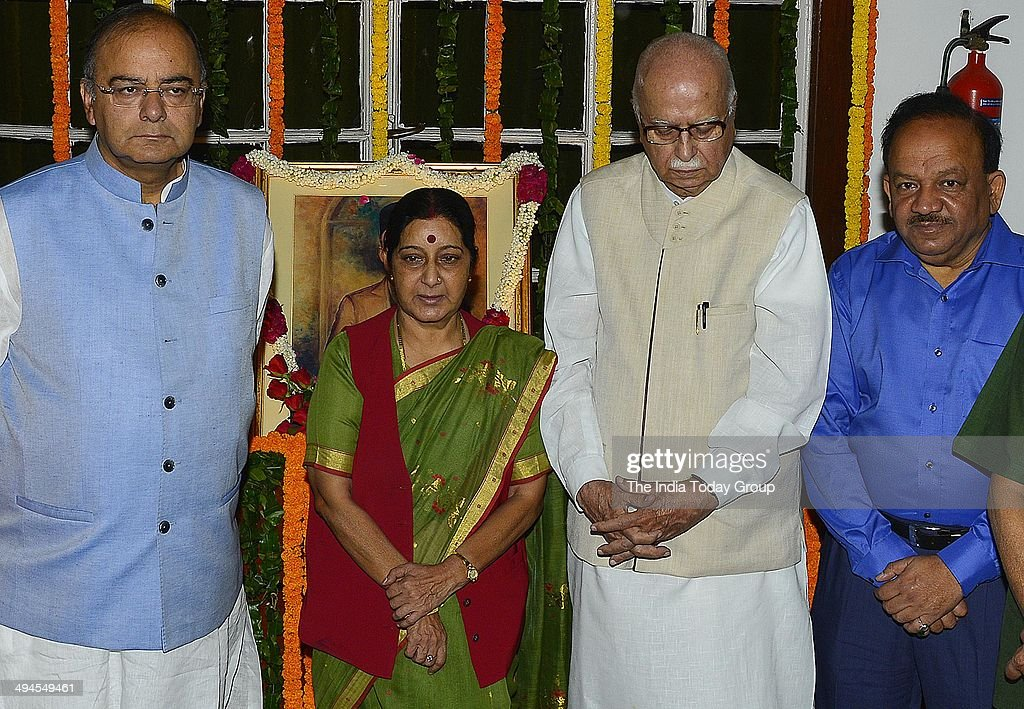 L K Advani & <a gi-track='captionPersonalityLinkClicked' href=/galleries/search?phrase=Sushma+Swaraj&family=editorial&specificpeople=2147656 ng-click='$event.stopPropagation()'>Sushma Swaraj</a> pay homage at the portrait of Swatantryaveer Vinayak Damodar Savarkar function on his birth anniversary at Parliament House on May 28, 2014 in New Delhi, India.