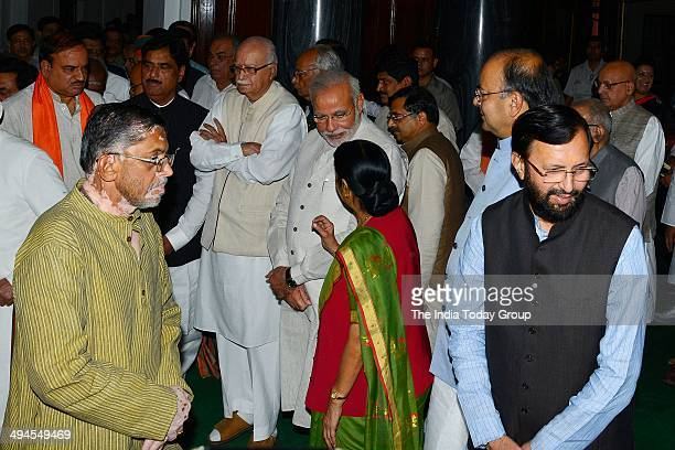 Advani Sushma Swaraj pay homage at the portrait of Swatantryaveer Vinayak Damodar Savarkar function on his birth anniversary at Parliament House on...