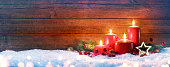 Four Red Candles With Christmas Decoration