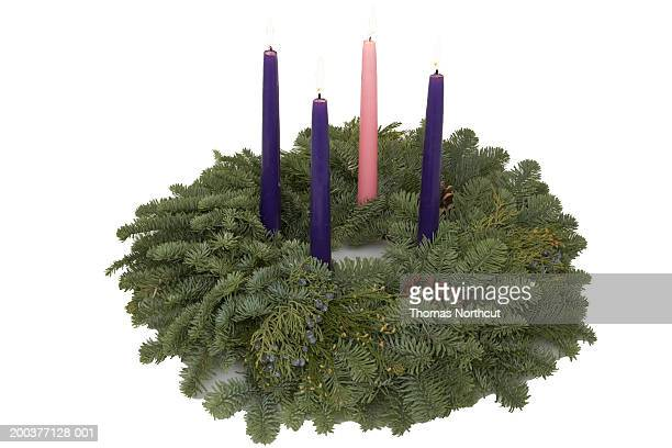 Advent wreath with burning candles, elevated view