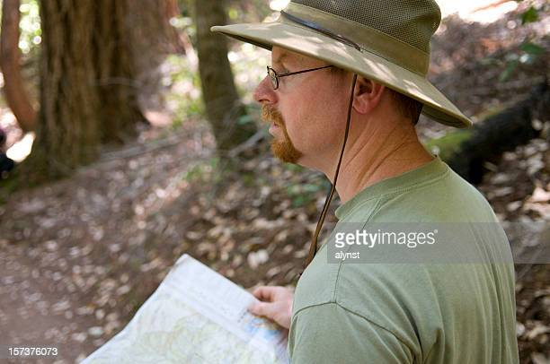 Adventure Hiker Searching For Trail