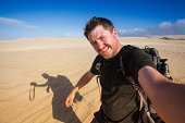 Adventure photographer self portrait in sand dunes
