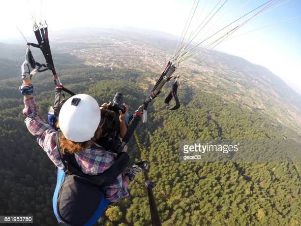 Adventure photographers flying with paragliding
