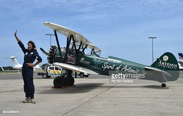 Adventurer Tracey CurtisTaylor waves after arriving in her vintage opencockpit 1942 Boeing Stearman aircraft at Sydney International airport in...